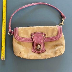 Coach tan and pink mini phone purse